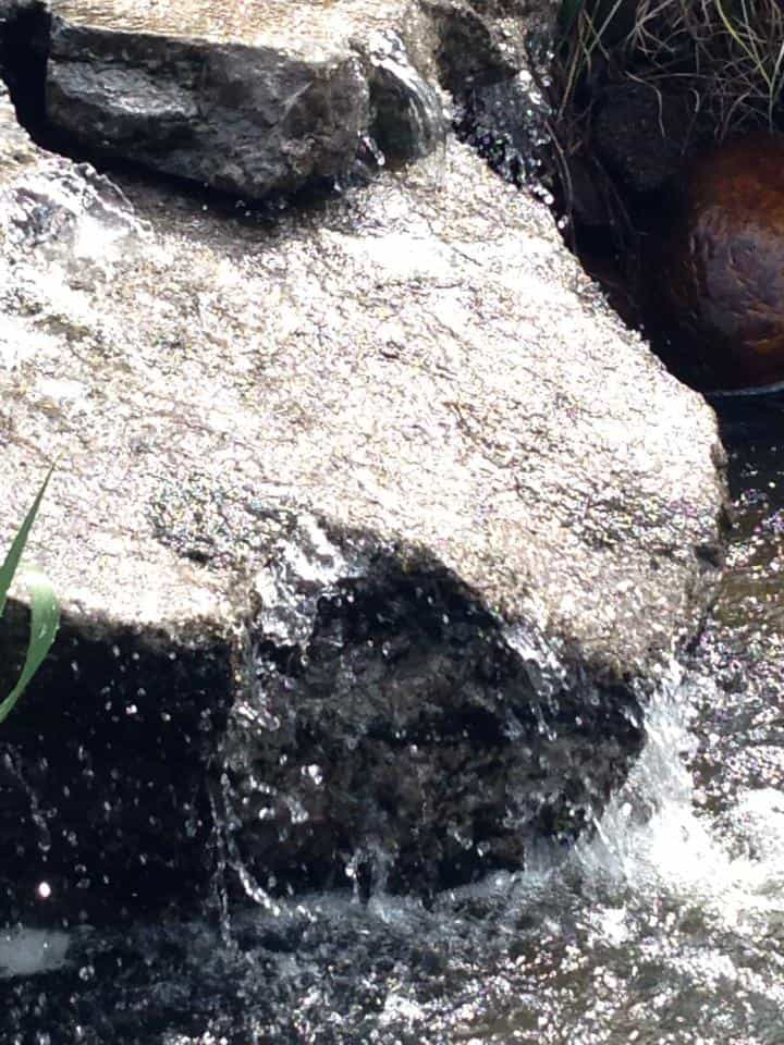 water flowing over rock