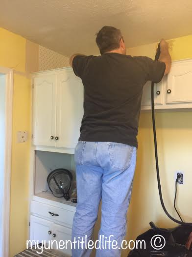 hubby removing wallpaper
